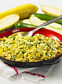 A courgette medley with sweetcorn in a pan