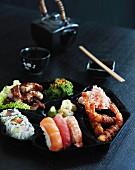 Japanese food on a black plate