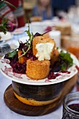 Baked Camembert with a beetroot salad on a garden table