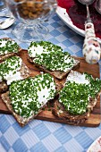 Slices of bread topped with cream cheese and chives