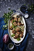 Meatballs in a Thai green curry sauce with roasted aubergines