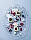 Yoghurt panna cotta with berry coulis, fresh berries and meringue splitters