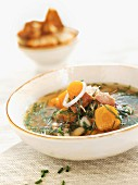 Herb fish soup with grilled bread