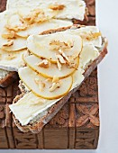 Slices of bread topped with Camembert, pears and walnuts