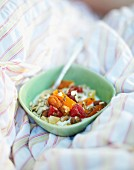 Muesli for breakfast in bed in a field