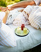 Children with fruit juice for breakfast in bed in a field