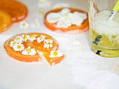 Candied orange peel decorated with daisies