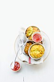 Mini courgette and ricotta flans with tomato coulis