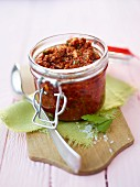 A jar of tomato pesto