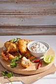 Beer-battered hake with a yoghurt dip