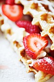 A sweet waffle sandwich with strawberries and cream