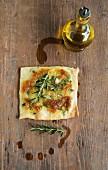 Mozzarella, onion and rosemary pizza