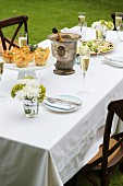 A table laid with appetisers in a garden