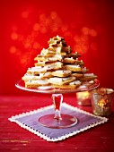 Shortbread biscuits stacked on a cake stand in the shape of a Christmas tree