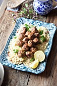 Moroccan lamb meatballs on a bed of couscous