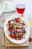 Black-eyed pea salad with plum tomatoes and red onions