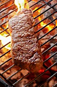 New York strip steak on a charcoal grill