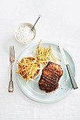 Steak with fries and mayonnaise