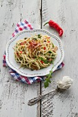 Spaghetti with bacon, chilli, mascarpone, rocket and capers