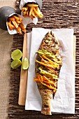 Grilled fish with chermoula and vegetables crudités