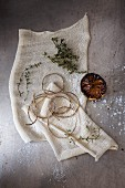 Kitchen twine, thyme and half a lemon on a cloth
