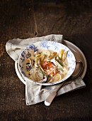 Fennel broth with salmon and mushrooms