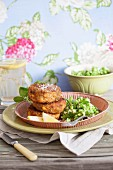 Salmon cakes with mushy peas