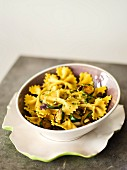 Farfalle with saffron, spring onions and courgettes