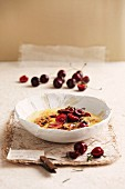 Gratinated almond pudding with cherries