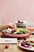A colourful salad with pork and cherries