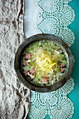 White cabbage soup with bacon