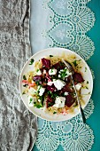 White cabbage and beetroot salad with sheep's cheese