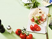Piadina (unleavened Italian bread) with tomato and rocket