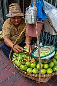 A vendor selling green mangos