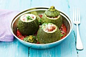 Round courgettes filled with minced meat in a tomato sauce
