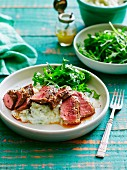 Lamb fillet with mashed cauliflower, pear and mint with a rocket salad