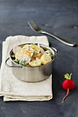 Broccoli and potato salad with radishes, onions and dill