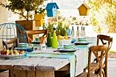 Bird houses hung over set table
