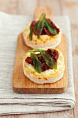 Vol-au-vents filled with feta cheese, dried tomatoes and sage