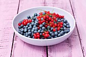 A bowl of redcurrants and blueberries