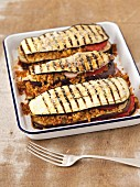 Grilled, gratinated aubergines with bulgur and tomatoes