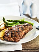 Strip steak with asparagus and potatoes