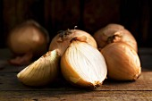 Brown onions on a wooden table