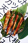 Teriyaki skewers on shiso leaves (Japan)