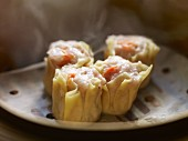 Siu Mai Dim Sum (Cantonese pork and prawn dumplings) in a steamer