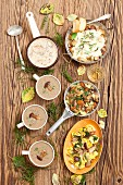 Various porcini mushroom dishes: soup, sauce, tortellini, bake with potatoes and porcini mushrooms with mozzarella