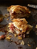 Chicken, fig, ham and feta in filo pastry on a baking tray