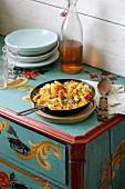 Potato orzo pasta with apple-sauerkraut on a farmhouse sideboard