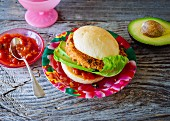 A vegan Mexican Burger: burger with tofu and salsa sauce