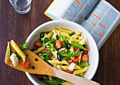 Pasta salad with rocket, cherry tomatoes and feta cheese